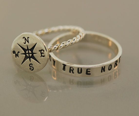 A sterling silver compass is featured with a hand stamped band. The band is stamped with You are my true north. Compass comes on a rope style