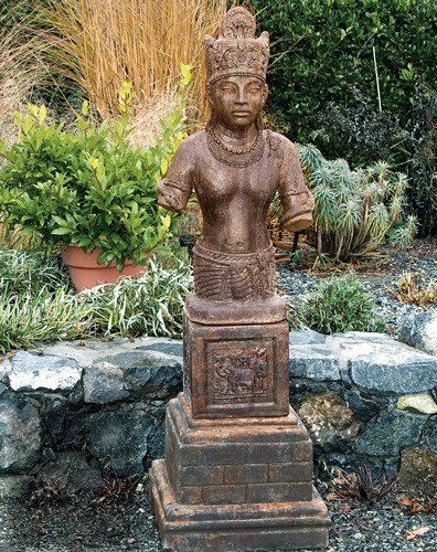 Vishnu. Stained ornamental concrete statue for Japanese garden or outdoor patio .