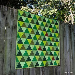 Green baby quilt, equilateral triangles