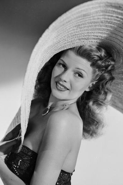 Rita Hayworth: The original glamour-girl known for her vixen film roles. She oozed sultry style in her off-screen outfits too. She was amongst the first to wear off-the-shoulder shirts, and showed off her legs in glittering gowns with splits to the hip. Photo by Getty Images