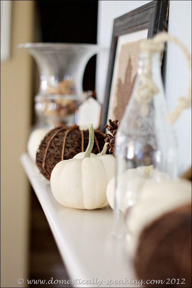Natural Autumn Mantel: white pumpkins, ,acorns & pinecones