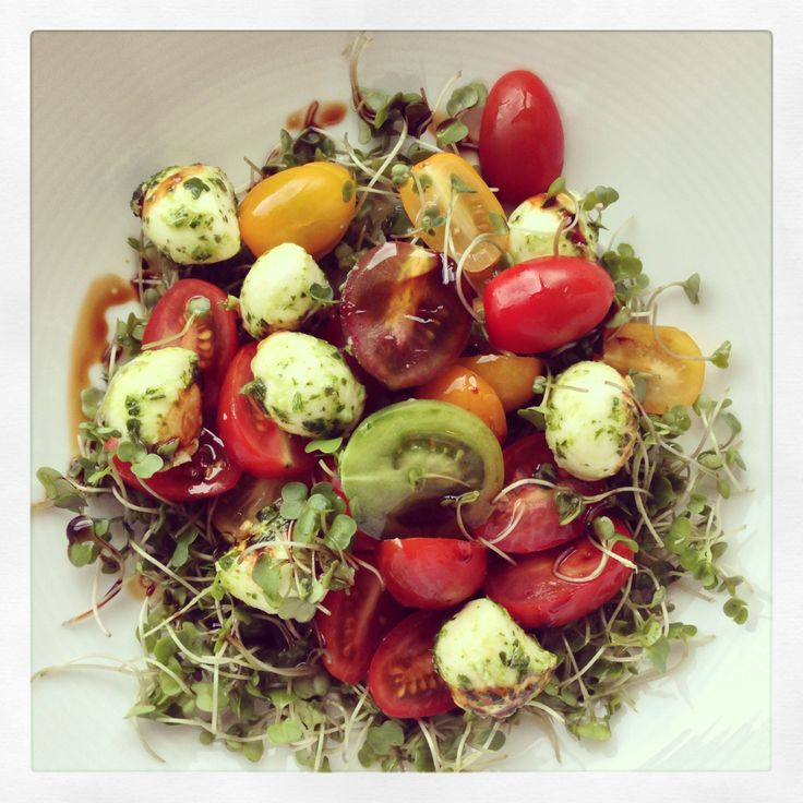 Zara's marinate bambini bocconcini, medley tomates and locally grown kale micro greens drizzled with E.V.O.O. and balsamic vinegar. www.zarasdeli.com