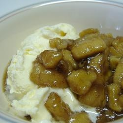 """Slow Cooker Bananas Foster   """"Banana slices are cooked in a rich butter and rum sauce with walnuts and coconut. Serve warm over vanilla ice cream."""""""