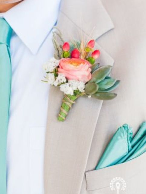 Clear aqua tie, peachy pink rose, spring green greenery, and fuchsia rose buds on a light taupe background. All perfect colors for you.