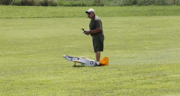 Model airplanes buzzed over the Cloud Jockey's airstrip Saturday afternoon before the rains, delighting those who turned out to watch.