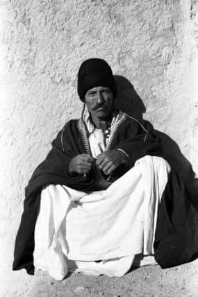 Portrait of a man, a Yazidi elder, sitting on the ground. 1950, Jabal Sinjar