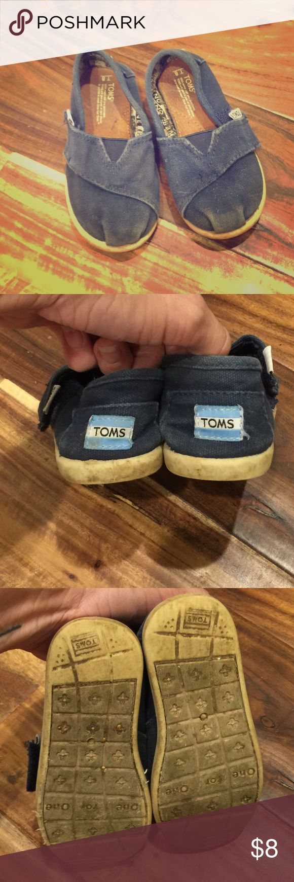 Kids Navy Toms canvas shoes Kids Navy Toms canvas shoes. GUC, size 8. Navy canvas, cream sole. TOMS Shoes Sneakers