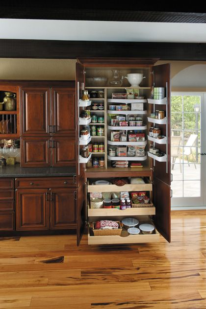 StarMark Cabinetry Super Chef Pantry. Five adjustable turntables, four adjustable door mount shelves and three adjustable roll out trays in lower portion.
