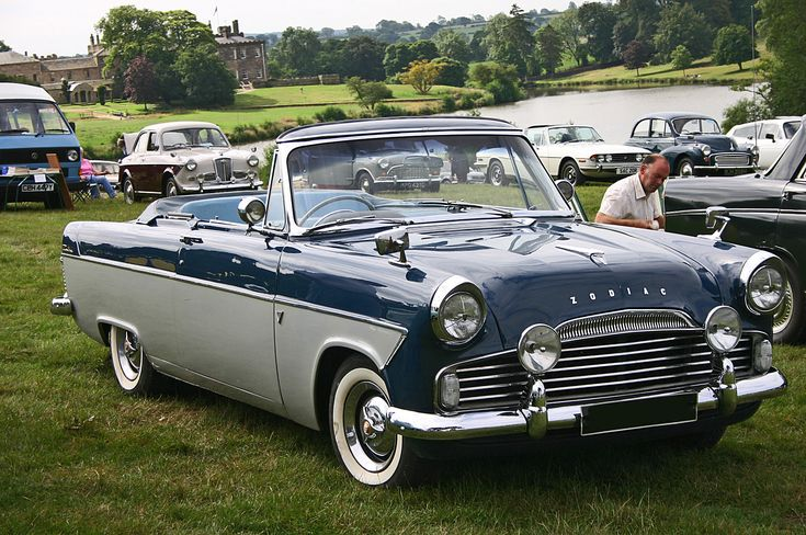 1960 Ford Zodiac Mk2 206e  convertible. The Mark II Zodiac was slightly altered to distinguish it from the lesser variants, having more elaborate tail-end styling and at the front a different grille, two-tone paint, whitewall tyres, chrome wheel-trim embellishers and gold plated badges.