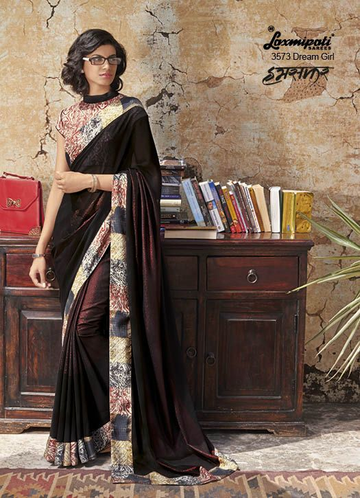Rare Yet Ravishing Black coloured Georgette Saree with Broad Digital Self Designed Printed Lace which will perfectly apt for Formal and Evening wearing and will make you look Stunning. It carries Maroon Pashmina Blouse.