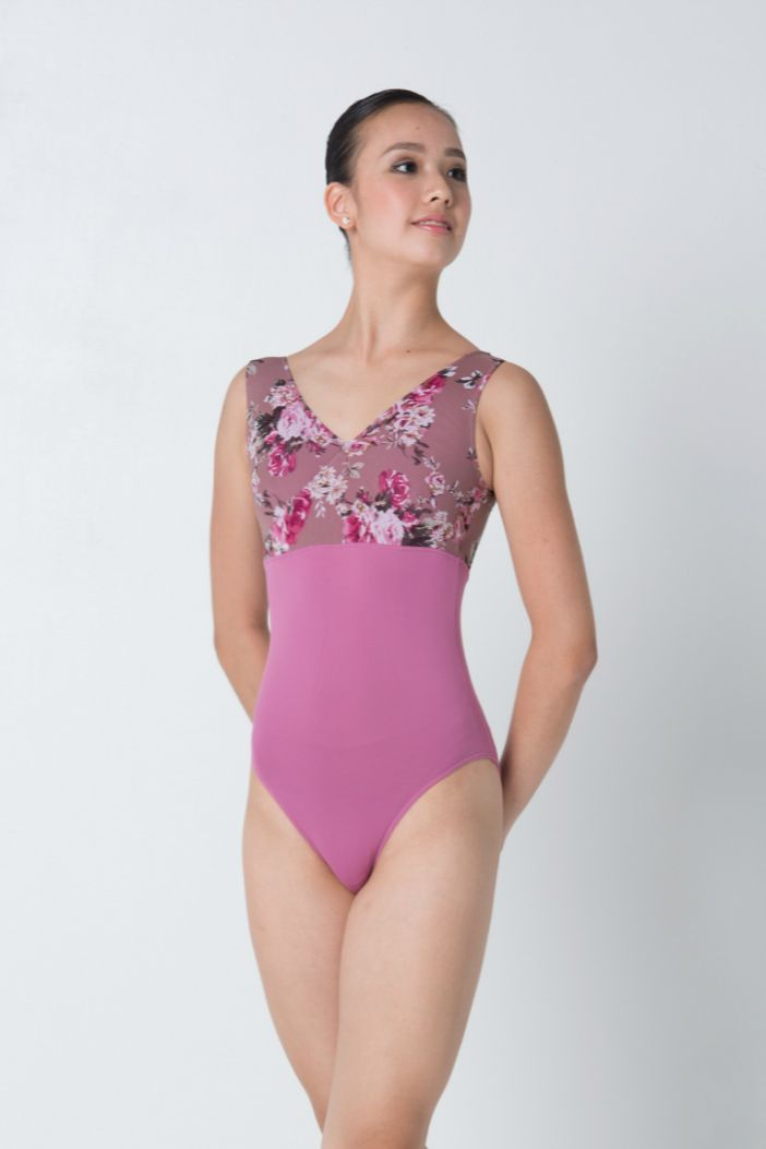 Tank leotard with roses in hues of pretty pinks. Comes with lining. While stocks last.