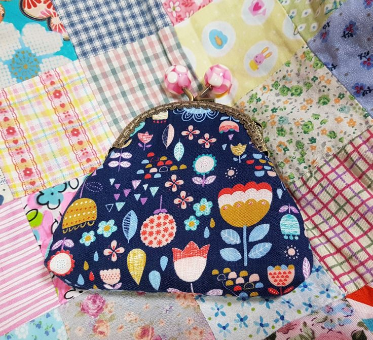 Lovely flowery kiss lock purses, entirely handstitched