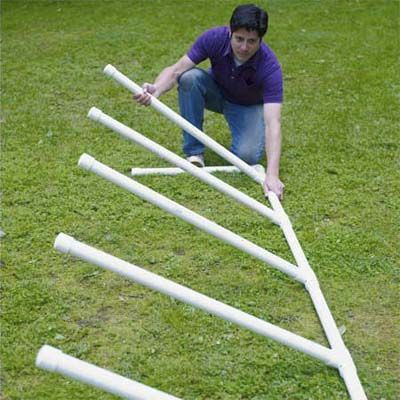 Build a complete agility course with jump bars, weave poles and a teeter totter. Click through to see step-by-step instructions, plus the tools and materials to use.