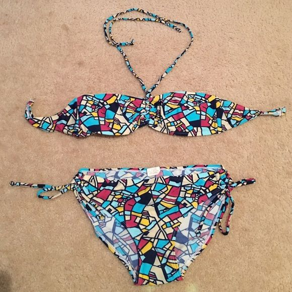 Stain glass bikini ONLY WORN ONCE! Stain glass bikini! Very cute for the summer time! A tie up around the neck as well as a hook in the back that clasps together, the bottoms have bows to secure each of the sides. To help figure out sizing I am 5'0 and 120 pounds and a 34d and the top doesn't fit me and the bottoms are a little snug. Sweet victorian  Swim Bikinis