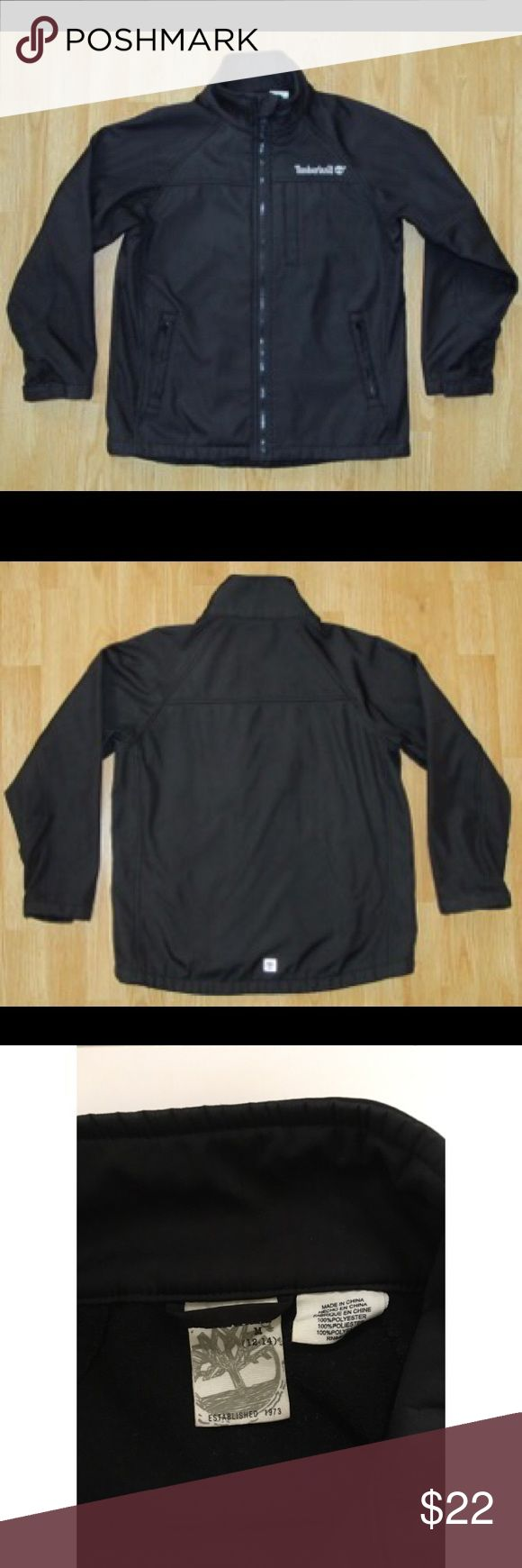 "Timberland black Jacket coat boys 12-14 Very nice Timberland jacket/coat in boys size M 12-14.  Black.  Full zip front covers the neck.  Zip pockets. Velcro on sleeves.  Zip pockets. Fleece lined.  Texture is like a very thick nylon. Polyester.  Excellent pre-owned condition.  Measures about 23"" long from top shoulder. Timberland Jackets & Coats"