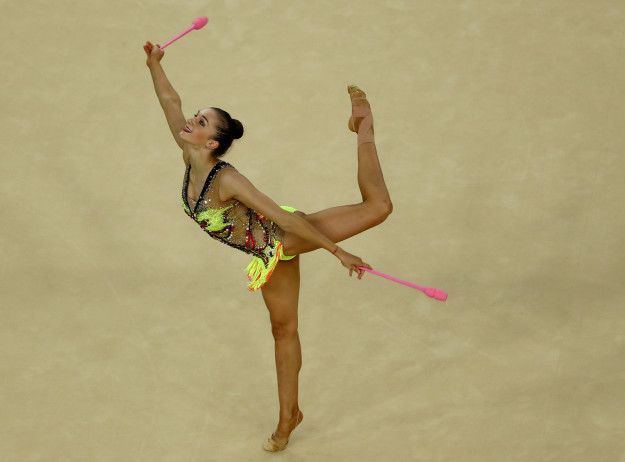 This is Ekaterina Volkova of Finland. Where did you get those pink clubs, Ekaterina? Asking for a friend.