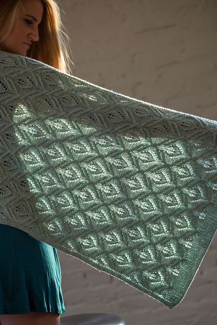 dk - A luxurious scarf or wrap, you'll want to envelop yourself in this cozy garment. The cable and lace stitch pattern is fun to knit, but rest rows mean you won't be pulling your hair out when you challenge yourself to this project.
