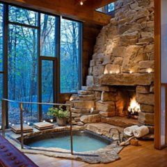 Dream home… indoor hot tub RIGHT NEXT TO the fireplace!