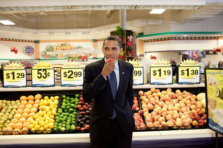 President Barack Obama Eats A Peach Following A Town Hall Meeting At Kroger's Supermarket