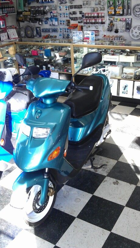 Rexy custom paint job. I did for Motor Source moped shop in Honolulu Hawaii.