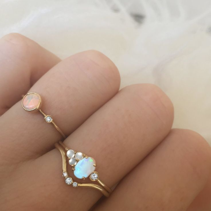 -1.2mm solid 14kt gold -6x4mm Australian opal -x3 pieces of 2mm white freshwater pearl -1.4mm VS1 white diamond Pairs perfectly with our diamond arc ring! *100% hand-crafted in the USA *FREE shipping