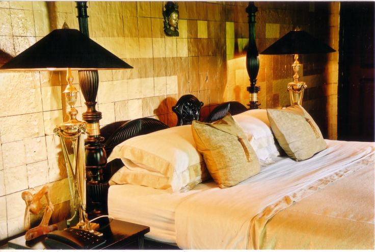 Gold foil tiling and dramatic lamps create the feel of opulance.