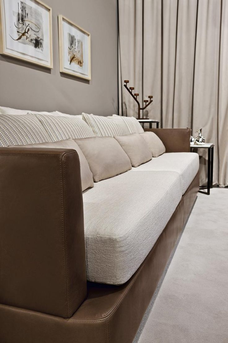 Detail of the Tancredi sofa, covered with fabrics and leather, by Oasis.