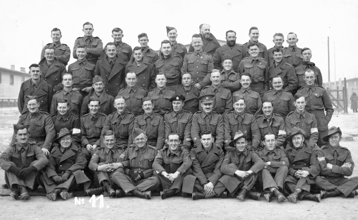 """Group photo of captured allied troops (British, Australians and New Zealanders) at Stalag XVIIIA POW camp. The conditions of captivity of allied soldiers were vastly better than those the Germans reserved for the Russians. Here we have smiles, clean shaven faces, clean uniforms, and a general appearance of """"normality"""". Food was also more than adequate."""