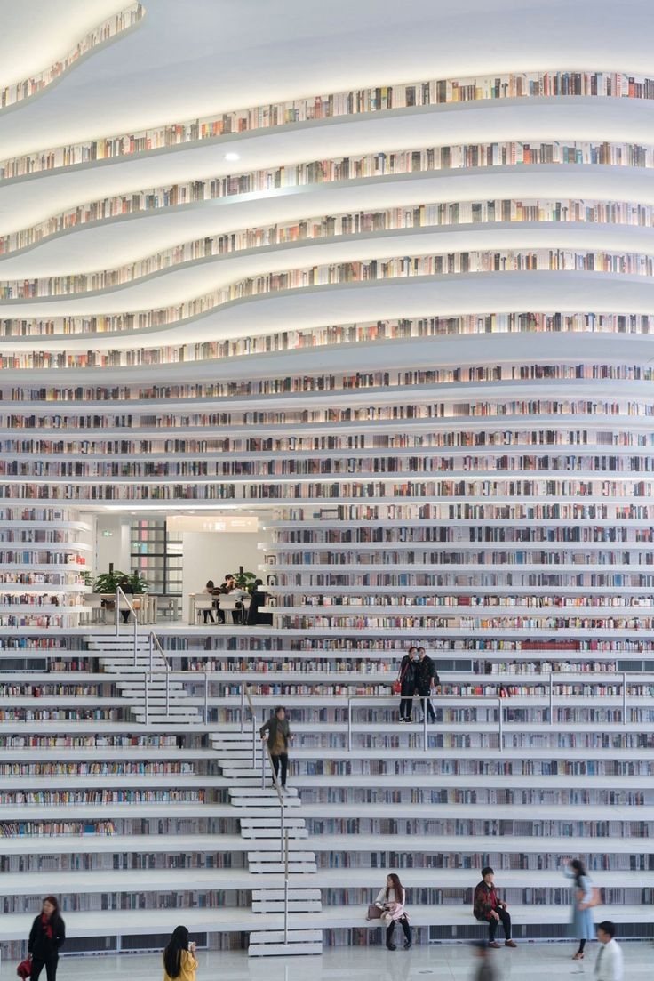 Tianjin Binhai Library, located outside Beijing, has massive bookshelves that contour the library's walls, rolling across the ceiling like waves. [1350 × 2024] : RoomPorn