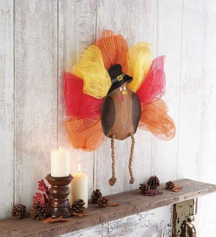 Painted burlap and felt door hanger features Thanksgiving turkey with oversize mesh feathers, Pilgrim hat and dangling twine legs  $35 at Party Cup Express