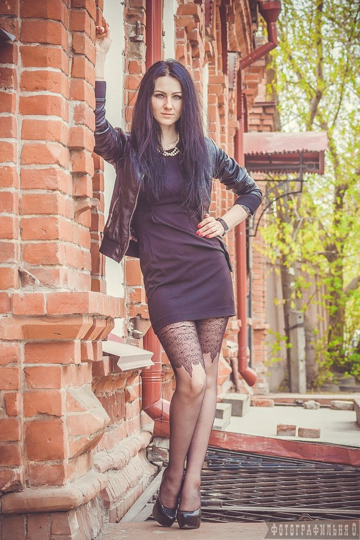 Girl with black hair in black dress near the brick building by Vyacheslav  Kolomeets on 500px