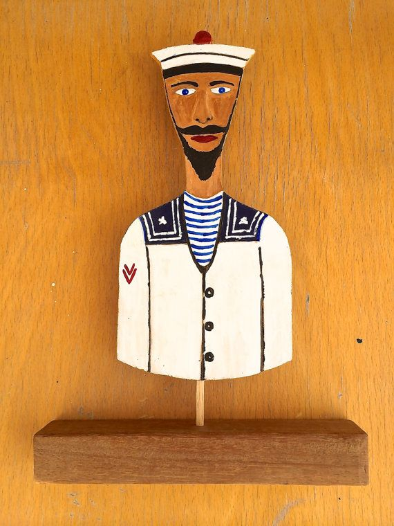 Hand cut and painted Navy Sailor old style figure - Home decor - Solid oak wood & Ply wood - Acrylic paint  Product details  - Hand cut and painted - Unique design (only 1 piece produced) - Figure made from ply wood - Base made from solid oak wood - Collectible piece MSN (manufacturer's serial number) MSN 001  Product Dimensions  20cm width x 28cm height (including base stand) x 3cm depth (the base) by Think4HandmadeArt, €25.00
