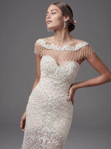 Sottero and Midgley - annika leigh, This vintage-inspired wedding dress features exquisite bead and pearl crosshatch detailing. Fit-and-flare silhouette complete with strapless sweetheart neckline and short Rivie jersey lining, creating an illusion skirt. Finished with zipper over inner elastic closure. An illusion capelet accented with beaded lace appliqués, crosshatching, and Swarovski crystals sold separately.