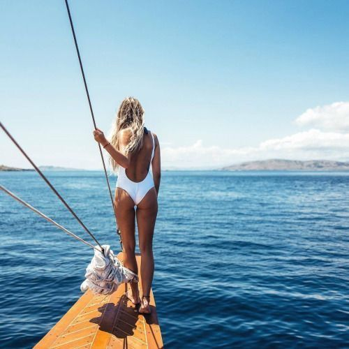 Must-haves for Summer: white one piece swimsuit.