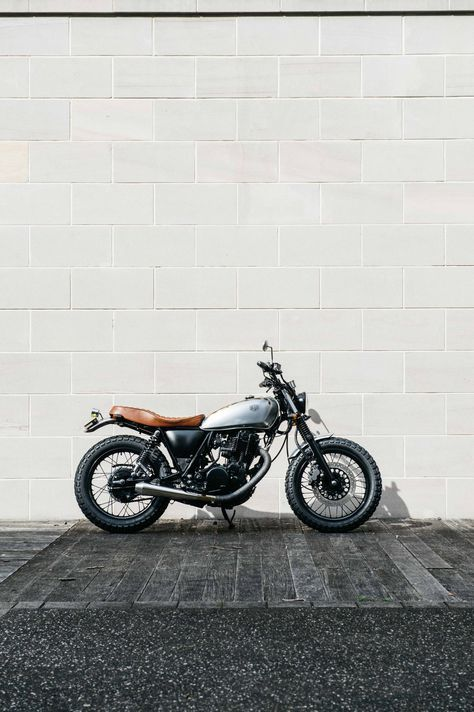 The base of this build was a 2014 Yamaha SR400. With its EFI and tough-as-nails reputation, it is the perfect riding partner to dance streets and ride the highways with. So Camperdown chief, Jeremy Tagand has... More
