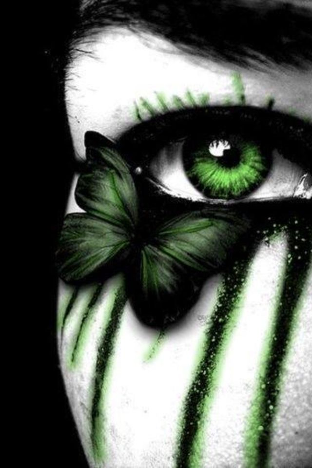dark makeup. green eyes. green butterfly. dark beauty.