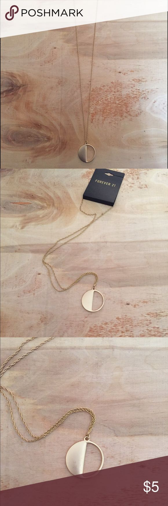 Forever 21. Long gold necklace half circle. New with tags. Never worn. Good condition. Very cute. Forever 21 Jewelry Necklaces
