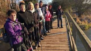 Image copyright                  Nordic Walkers / Facebook               With the clicking of poles and a determined stride, the Winchester Nordic Walking group is a distinctive sight as its members pound the Hampshire countryside. The day I bumped into them, all but one was...