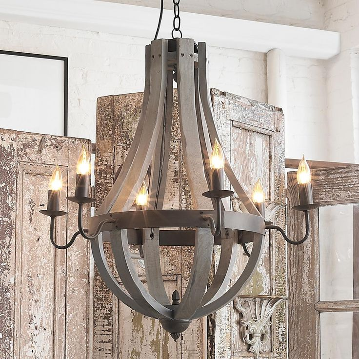 Wooden Wine Barrel Stave Chandelier Inspired by wooden slats from the vineyard, this bent-wood wine barrel chandelier is strapped with a dark bronze metal ring and 6 candelabra arms in rustic simplicity. Naturally aged wood finishes include Dark or Light Wood, White wash, barn Red, moss Green, misty or stormy Gray and island Navy to coordinate with any decor from casual coastal or French country to urban farmhouse.