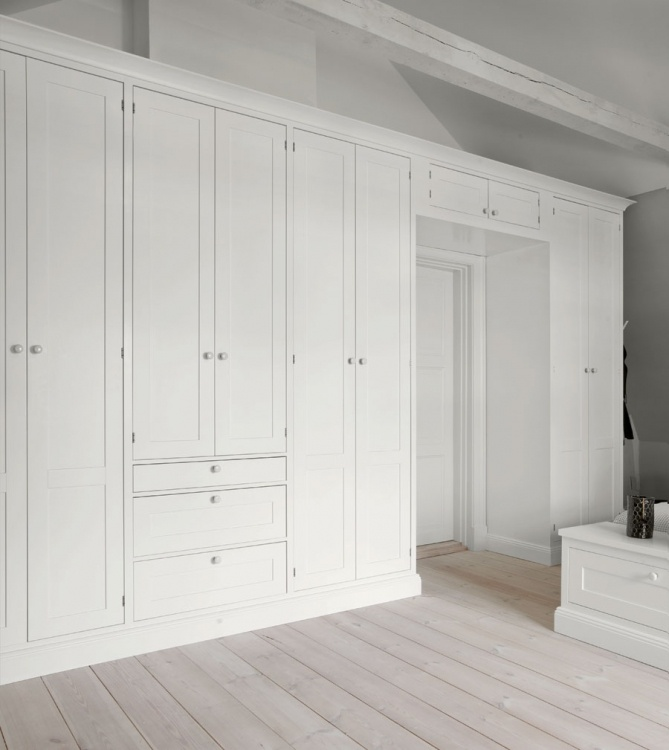 Wardrobes in Broby pure white handpainted on ash, white knobs in porcelain from France. kvanum.com