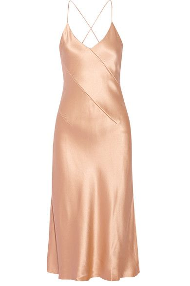 Cushnie et Ochs' Fall '16 collection is inspired by iconic silent film star Louise Brooks. Cut on the bias from fluid silk-charmeuse in a glossy champagne hue, this elegant 'Rosie' slip dress is designed with thin crisscrossing back straps. Complement it with metallic accessories.