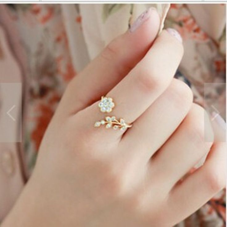 2016 The new European and American fashion temperament Zinc alloy hair twisted leaves wishful flower opening ring