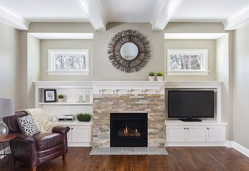traditional family room rock fireplace built in cabinets design