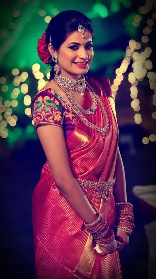 South Indian bride. Temple jewelry. Jhumkis.Red silk kanchipuram sari with contrast blouse.Braid with fresh flowers. Tamil bride. Telugu bride. Kannada bride. Hindu bride. Malayalee bride.Kerala bride.