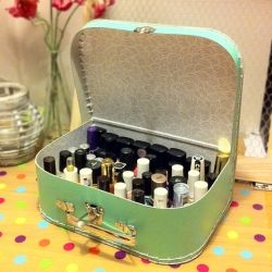 Use a suitcase as a cute storrage for your nail polishes. I