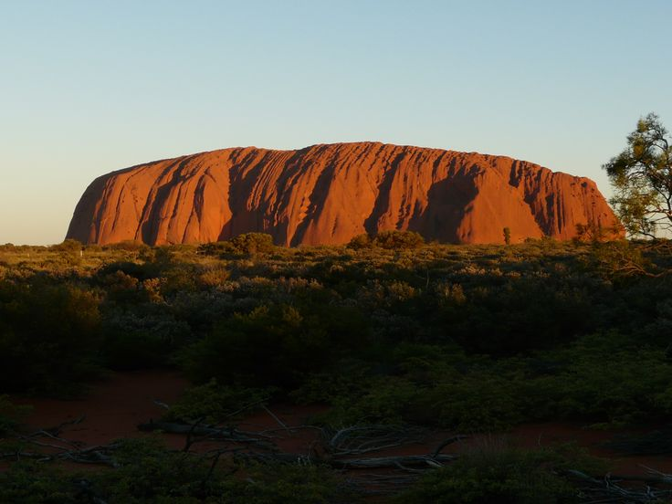 Sunset at Uluru - Amazing. Uluru (English pronunciation: /ˌuːluːˈruː/), also known as Ayers Rock is a large sandstone rock formation in NT