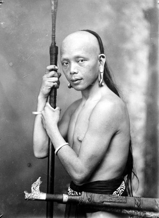 A Dayak with earrings and a lance (taken c. 1920, Dutch Borneo). The Dayaks are previously reputed to be headhunters by the Europeans. In the first half of the 19th century, the Dutch Colonial government in Eastern and Southern Borneo successfully curtailed the traditional headhunting culture by the Dayaks. In reality not all Dayaks were Hunter-gatherers, most Dayaks in the 19th century are actually farmers.