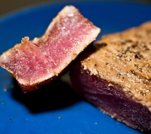 Grilled tuna steak.Use barbecue or charcoal grill to cook delicious and juicy tuna steak with spices and herbs.