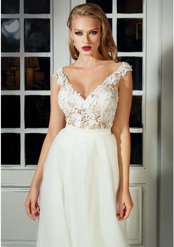 Princess wedding dress style Deep V cleavage and cups included Low-cut back The skirt closes at the back with zipper and hand made buttons