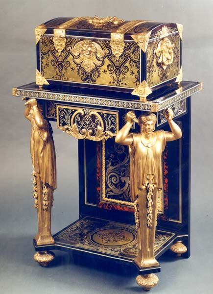 "Andre Charles Boulle attributed to  Louis XIV casket and stand (1685-1700) at Perrin Antiquaires, Paris.        The decorative ""gods"" or 'humans"" on the legs make this table amazing. I really like the delicate details of this furniture."